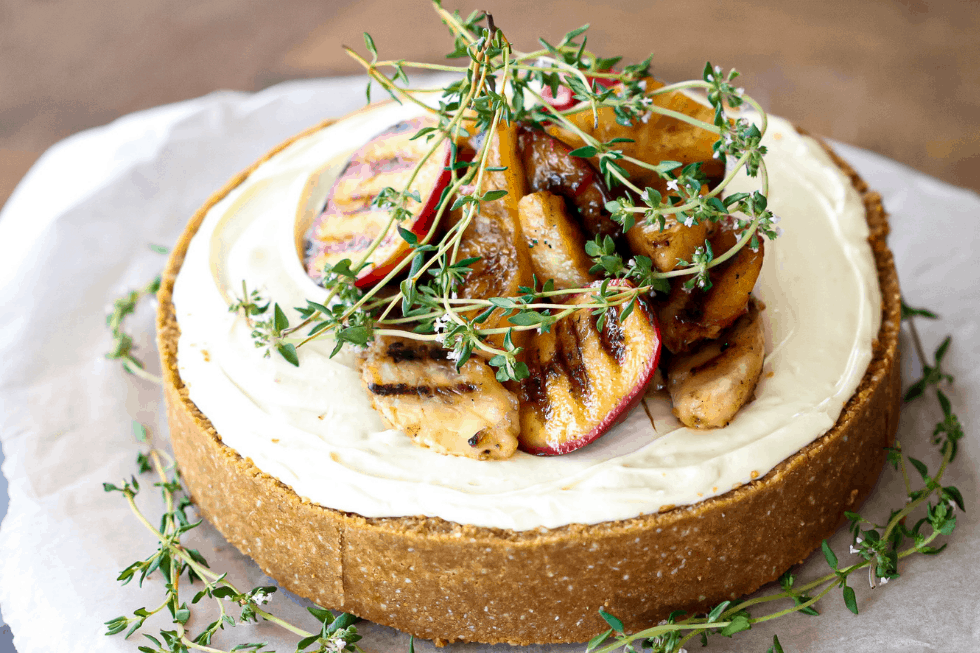 Vanilla bean cheesecake with frilled peaches and thyme